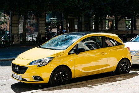 STRASBOURG, FRANCE - JUNE 10, 2017: New yellow Opel Corsa parked on the street in France Editorial