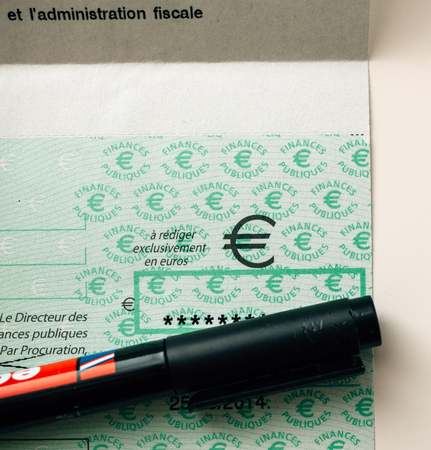 PARIS, FRANCE - JAN 1, 2015: Marker covering secret detail of French Cheque issued by the Direction Generale des Finances Publiques - the division of Economic Minister responsible for income taxes