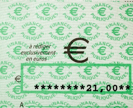 PARIS, FRANCE - JAN 1, 2015: Square image of French Cheque for 21 Euros issued by the Direction Generale des Finances Publiques paying for income taxes in France Editorial