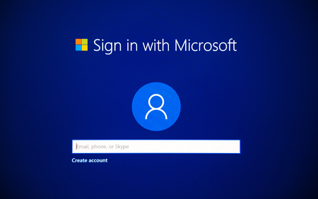 LONDON, UNITED KINGDOM - JUN 15, 2017: Blue screen detail with sign in with Microsoft account with email, skype, phone during Microsoft Windows installation and activation on a new PC workstation Editorial