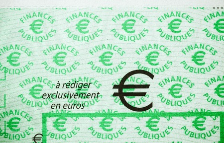 PARIS, FRANCE - JAN 1, 2015: Detail of French Cheque issued by the Direction Generale des Finances Publiques with text translates as To Fill only in Euros