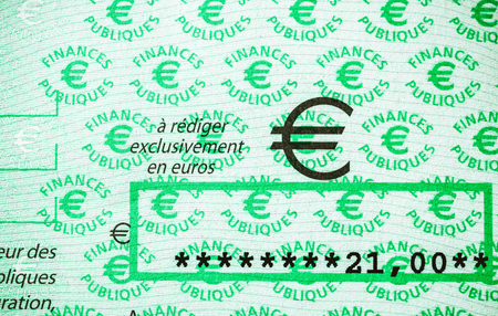 PARIS, FRANCE - JAN 1, 2015: 21 Euros on French Cheque issued by Direction Generale des Finances Publiques - division of Economic Minister responsible for income taxes