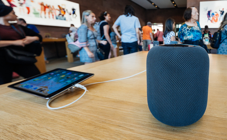 PARIS, FRANCE - JUL 16, 2018: People in Apple Store and the latest Apple Computers HomePod smart speaker with Siri and Apple Music Editorial