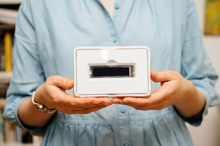 Woman hands holding new hard drive disk in plastic box with high read and write speed