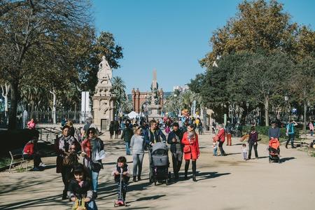 BARCELONA, SPAIN - OCT 11, 2017: People and children on street of Barcelona city center in beautiful Parc de la Ciutadella in sunlight