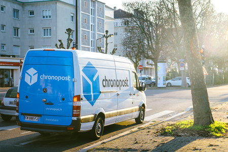 STRASBOURG FRANCE - DEC 19, 2016: DPD from La Poste delivery vans in center of the city on sunny street early in the morning. Chronopost and DPD is part of French group La poste
