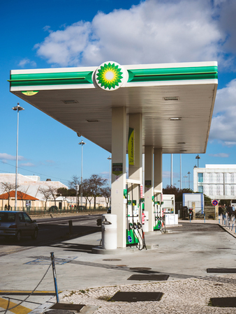 LISBON, PORTUGAL - FEB 10, 2018: View of modern BP British Petroleum gas station with green element on paved concrete street in sunlight near harbour