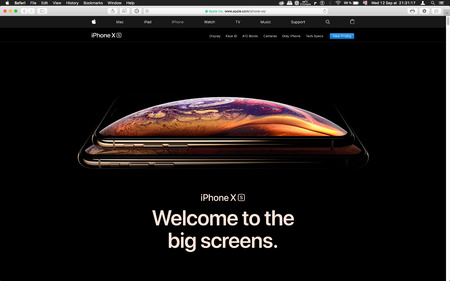 London, United Kingdom - September 12, 2018: Latest golden Apple iPhone XS iPhone XS Max iPhone X R smartphone computer, seen on computer MacBook display welcome to big screens
