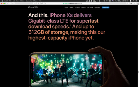 London, United Kingdom - September 12, 2018: Gigabit class LTE internet speed on latest golden Apple iPhone XS iPhone XS Max iPhone X R smartphone computer, seen on computer MacBook display
