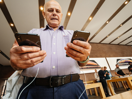 STRASBOURG, FRANCE - SEP 21, 2018: Apple Store with customers people buying admiring deciding which one to buy from the new latest iPhone Xs and Xs Max smartphones telephones