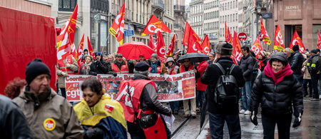 STRASBOURG, FRANCE - MAR 22, 2018: CGT General Confederation of Labour workers with placard at demonstration protest against Macron French government string of reforms - central street demonstration