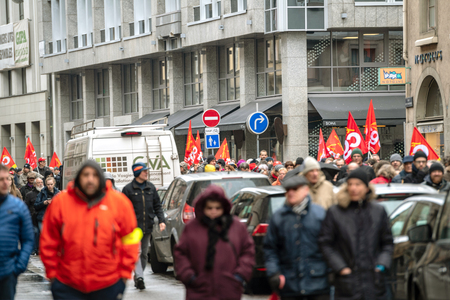 STRASBOURG, FRANCE - MAR 22, 2018: CGT General Confederation of Labour workers with placard at demonstration protest against Macron French government string of reforms - closed central street full with people