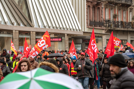 STRASBOURG, FRANCE - MAR 22, 2018: French people, CGT General Confederation of Labour workers with placards at demonstration protest against Macron French government string of reforms Editorial