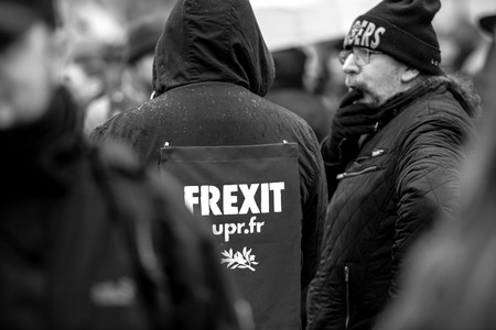 STRASBOURG, FRANCE - MAR 22, 2018: People gathering in Place Kleber square during CGT General Confederation of Labour demonstration protest against Macron French government string of reforms - man with Frexit sign on back of his jacket