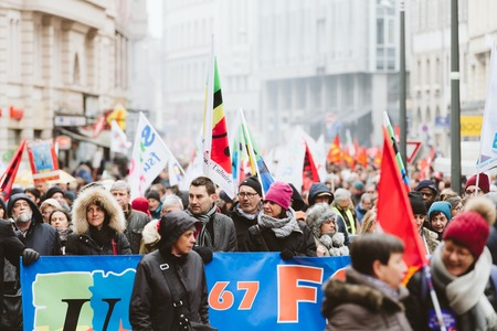 STRASBOURG, FRANCE - MAR 22, 2018: CGT General Confederation of Labour workers with placard at demonstration protest against Macron French government string of reforms - front view of crowd