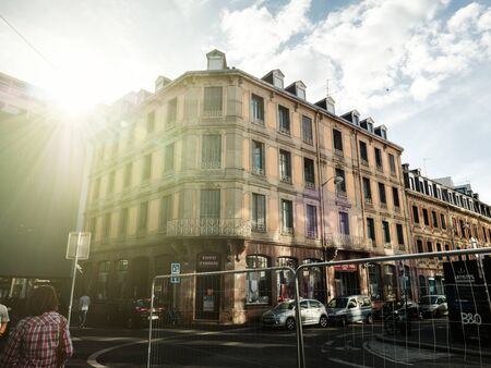 STRASBOURG, FRANCE - JUN 23, 2018: Toto Tissues store in Strasbourg with beautiful building and Rue Marbach and Rue Thomann intersection sunlight flare Editoriali