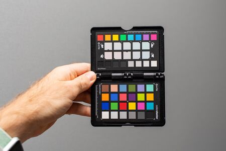 PARIS, FRANCE - OCT 29, 2018: Professional Color Passport by X-Rite Color Reference Targets and camera calibration sfotware before the professional photo session shooting studio shot on gray background Sajtókép