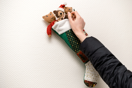 POV Woman arranging Christmas stocking decoration on the wall - ready to receive the winter presents