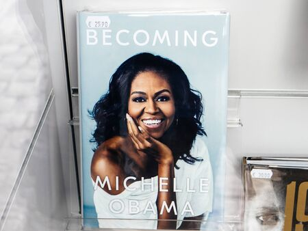 Paris, France - Dec 16, 2018: Boockstore stand with cover of Becoming Michelle Obama the autobiographical memoir of former United States First Lady Michelle Obama Editorial