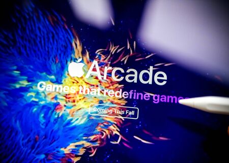 Paris, France - Mar 27, 2019: Apple Arcade icon seen on modern Ipad Pro tablet featuring the new subscription model for over 100 groundbreaking new games coming this fall text Editorial