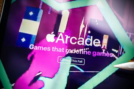 Paris, France - Mar 27, 2019: Apple Arcade icon seen on modern Ipad Pro tablet featuring the new subscription model for over 100 groundbreaking new games magenta tones Editorial