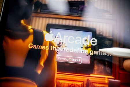 Paris, France - Mar 27, 2019: Focus on Apple Arcade icon seen on modern Ipad Pro tablet featuring the new subscription model for over 100 groundbreaking new games
