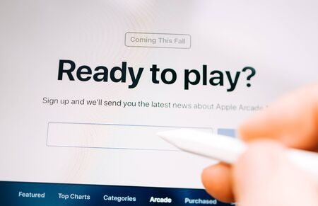 Paris, France - Mar 27, 2019: Focus on Apple Arcade features seen on modern Ipad Pro tablet featuring the Ready to Play text new subscription model for over 100 groundbreaking new games Editorial