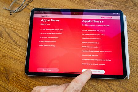 Paris, France - Mar 27, 2019: Apple News vs Plus a service which gives users access to more than 300 magazines for a monthly payment - price comparison and features