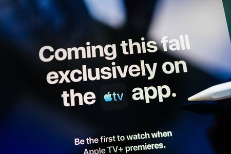 Paris, France - Mar 27, 2019: POV man holding Apple Pencil over the new iPad Pro Apple TV Plus streaming service coming this fall exclusively in Apple TV app