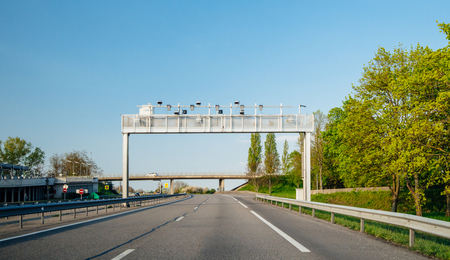 French autoroute highway security surveillance cameras and radars on poles on the empty highway