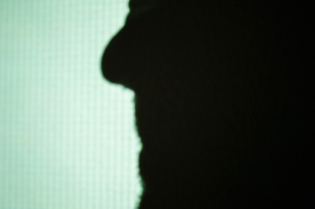 Abstract background shadows of male nose beard mouth on digital wall light from cinema projector on a wall Banco de Imagens