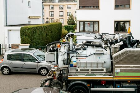 Paris, France - Apr 24, 2019: Detail mechanism of New Capellotto Sewage truck on city street in working process to clean up sewerage overflows, cleaning pipelines and potential pollution issues