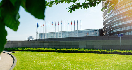 Wide facade of European Parliament View through green poplar trees of headquarter in Strasbourg a day before 2019 European Parliament election Stock Photo