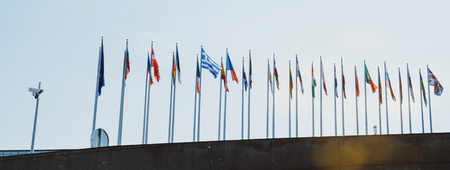 Side view of European union member flags waving in front of the Parliament days before Parliamentary elections on 26 may