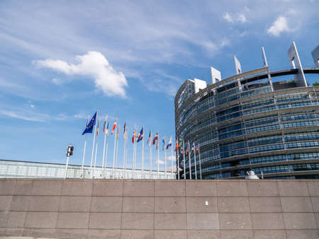 Strasbourg, France - May 26, 2019: European Parliament headquarter with all European Union flags waving - clear blue sky in background Editorial