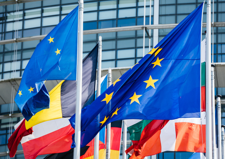 Square image flags of all member states of the European Union waving in calm wind in front of the Parliament headquarter on the day of 2019 European Parliament election. Stock Photo