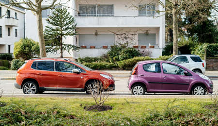 Strasbourg, France- Feb 23, 2017: Two Peugeot cars parked on French street