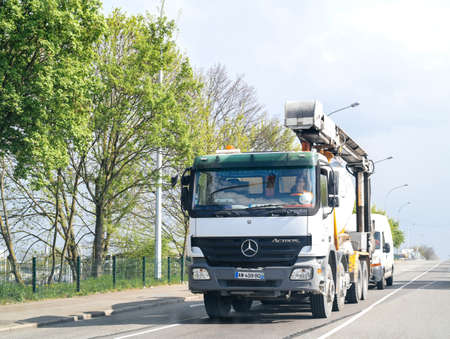 Strasbourg, France - Apr 4, 2017: New Powerful Mercedes-Benz Actros cement mixer truck on street in France