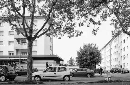 Strasbourg, France - May 3, 2018: Cite de lIll HLM Habitation a loyer modere rent-controlled housing French buildings with young group of arab boys - black and white Editorial