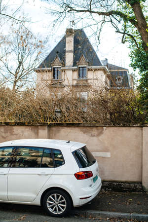 Strasbourg, France- Feb 19, 2017: Part of new Volkswagen car parked on French street with beautiful house in background
