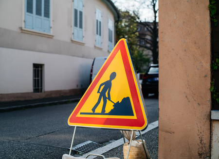 Construction roadworks warning sign ahead on French tiny street