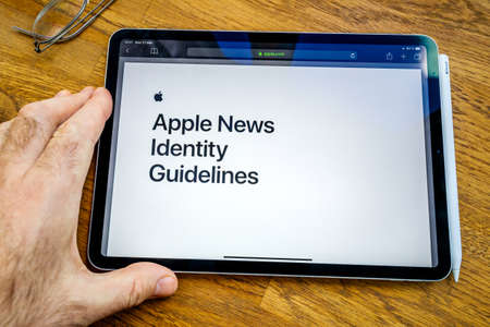 Paris, France - Mar 27, 2019: POV personal perspective on Apple News webpage seen on modern iPad Pro tablet featuring Identity guidelines