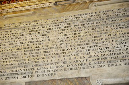 Italian text as seen on the ceiling in old apartment building in Florence, Italy Stok Fotoğraf