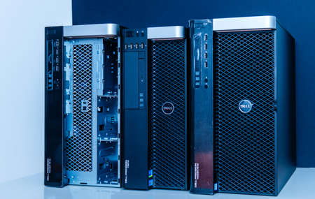 London, United Kingdom - Oct 2, 2017: Row of new Dell Precision T3610 T7910 Xeon workstation for heavy computing AI calculations blue color cast on of the workstation has open the front door for HDD access