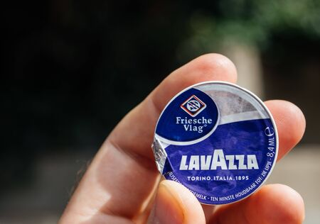Hoenderloo, Netherlands - Aug 17, 2018: POV man hand holding Lavazza coffee milk pack