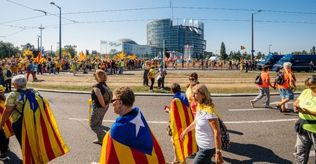 Strasbourg, France - Jul 2 2019: People walking holding Estelada Catalan separatist flags demonstrate protest front of EU European Parliament against exclusion of three Catalan elected MEPs Sajtókép