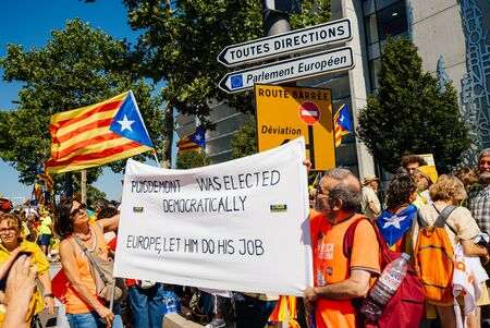 Strasbourg, France - Jul 2 2019: Puigdemont was elected democratically, Europe let him do his job placard during European Parliament session