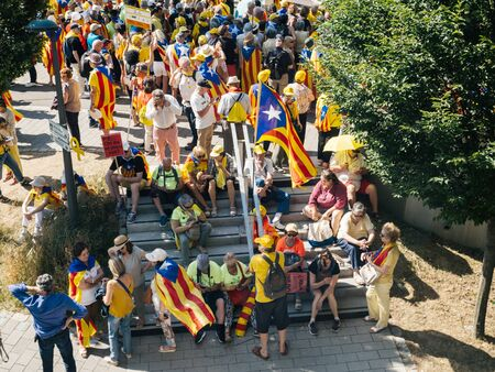 Strasbourg, France - Jul 2 2019: People resting on stairs at shadow at protest front of EU European Parliament against exclusion of three Catalan elected MEPs