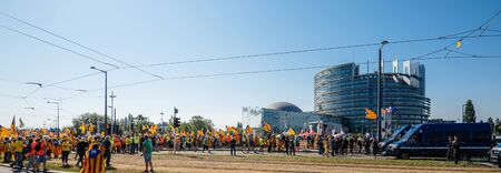 Strasbourg, France - Jul 2 2019: People holding Estelada Catalan separatist flags demonstrate protest front of EU European Parliament building against exclusion of three Catalan elected MEPs Sajtókép