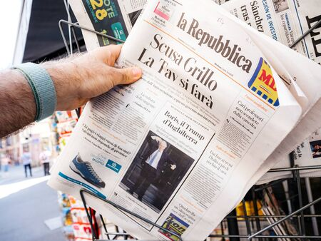 Paris, France - Jul 24, 2019: Boris Johnson appears on cover page of the German Die Welt newspaper as he becomes UK United Kingdom Prime Minister man taking from stand the newspaper